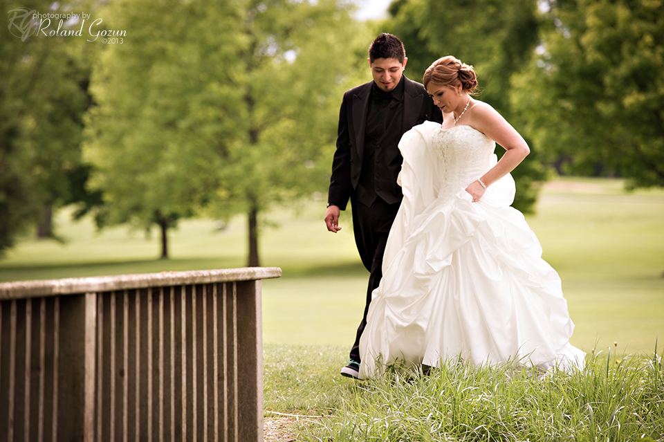 Bride and groom walk through Bonnie Brook Golf Course