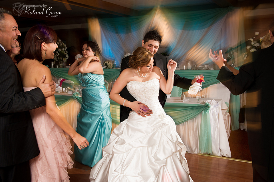 Bride and groom dance at indoor wedding reception